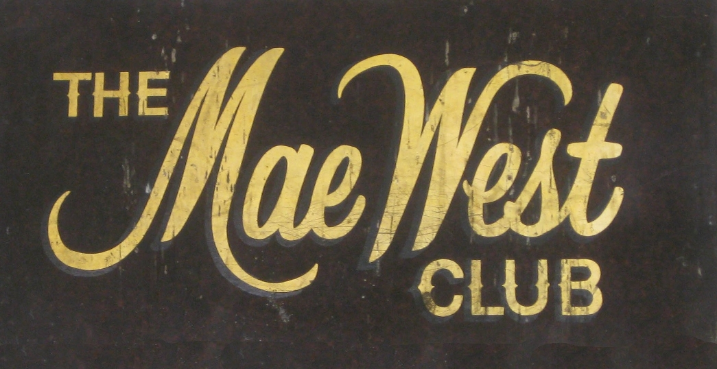 Old nightclub sign reading The Mae West Club