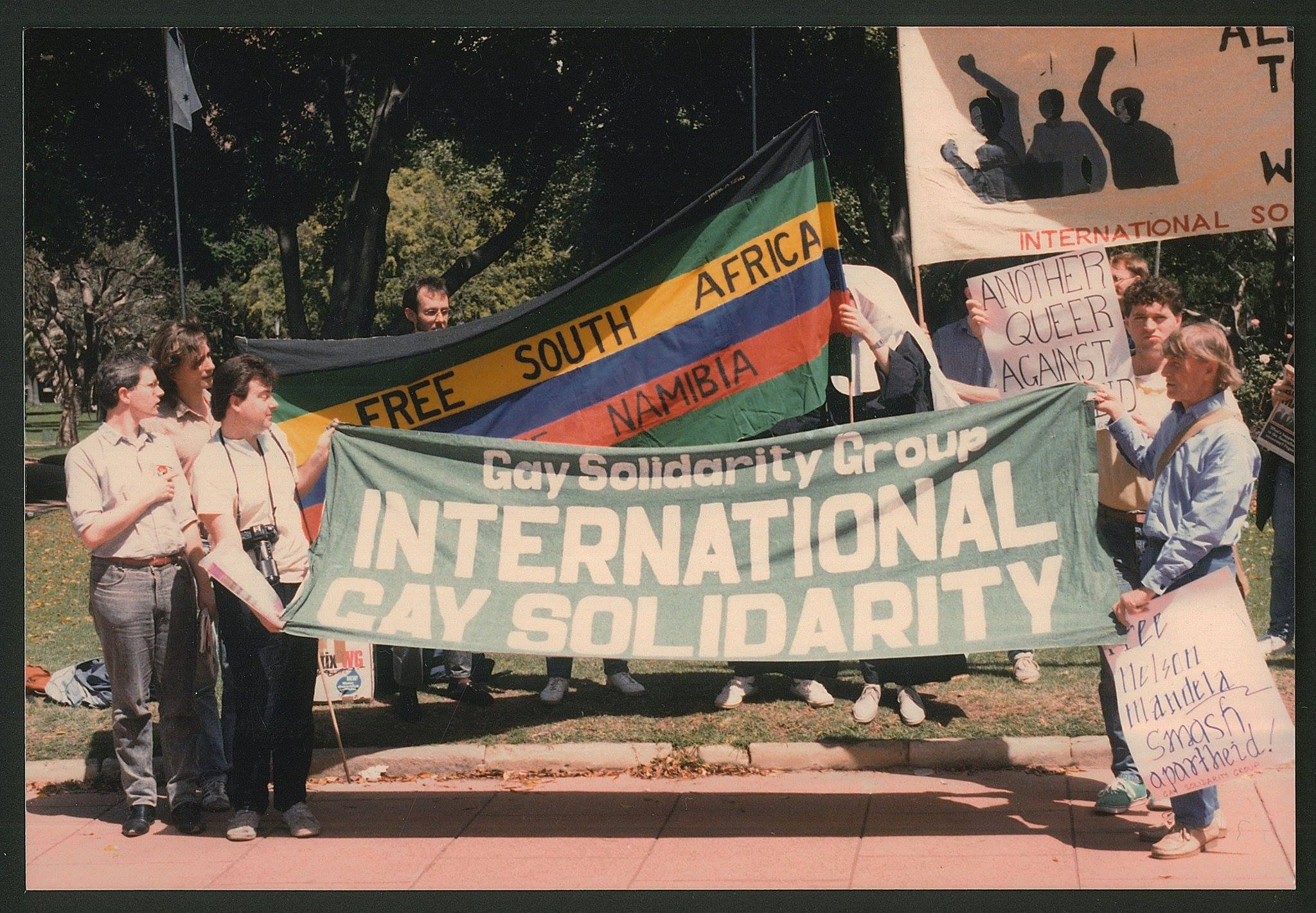 Ken Lovett (far right) with the Gay Solidarity Group at an anti-apartheid rally, Hyde Park Square, Sydney, c. March 1988